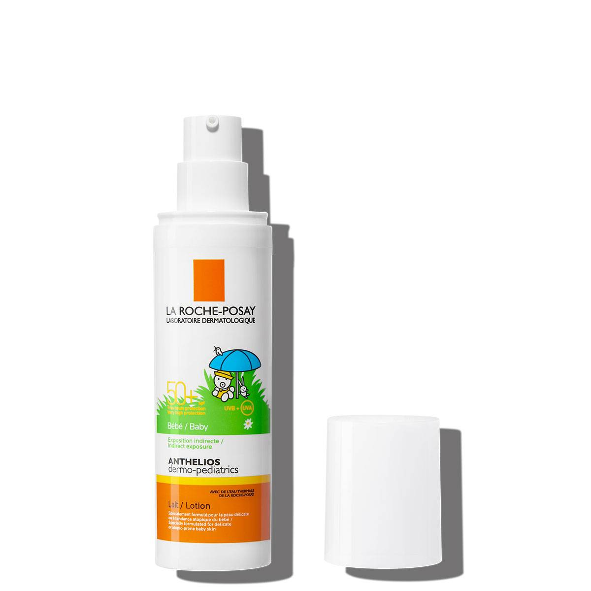 Confezione Anthelios dermo-pediatrics lozione SPF50+ con tappo accanto su sfondo bianco